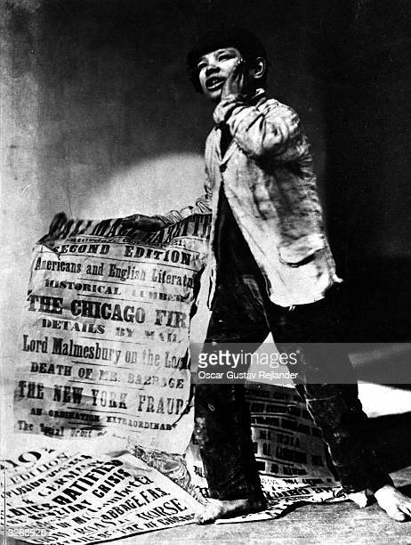 Young news vendor holding a poster announcing the Chicago Fire.
