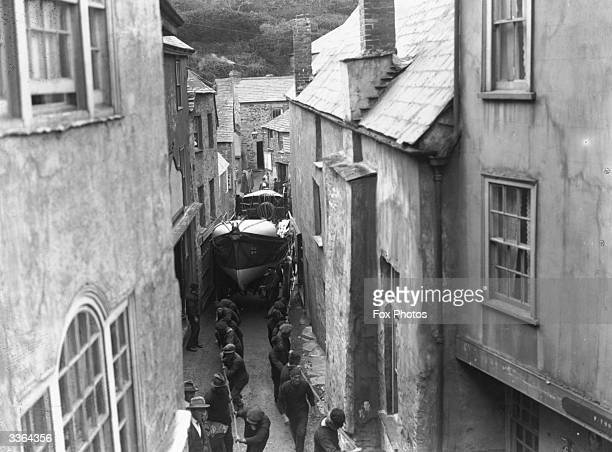 The lifeboat being pulled through the streets of Port Isaac, Cornwall in England.