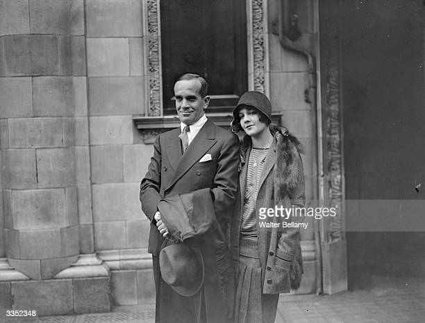 Russianborn American actor and singer Al Jolson star of the first talking picture 'The Jazz Singer' with his wife during a visit to London where the...