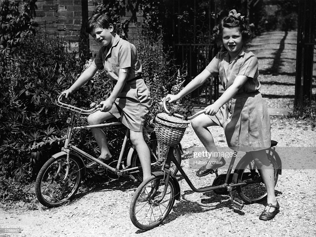 His Royal Highness Prince Edward (1935 - ) the eldest child of the Duchess of Kent with his sister Princess Alexandra (1936 - ) on their bikes in the garden of 'Coppins', their home in Buckinghamshire on the occasion of his eigth birthday.