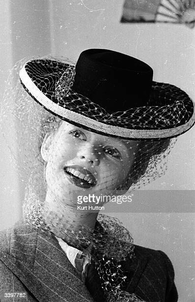 Star of 'Junior Miss' Peggy Cummins modelling a hat which she made herself from a design by Rose Bertin Original Publication Picture Post 1551 Junior...
