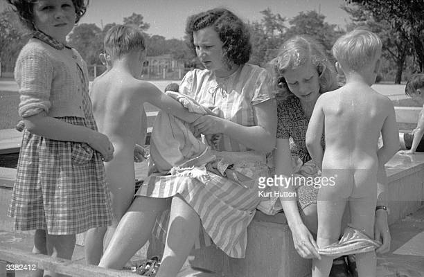 Children are dried off after swimming in the sea during a day off from one of the German schools where British children can receive an English...