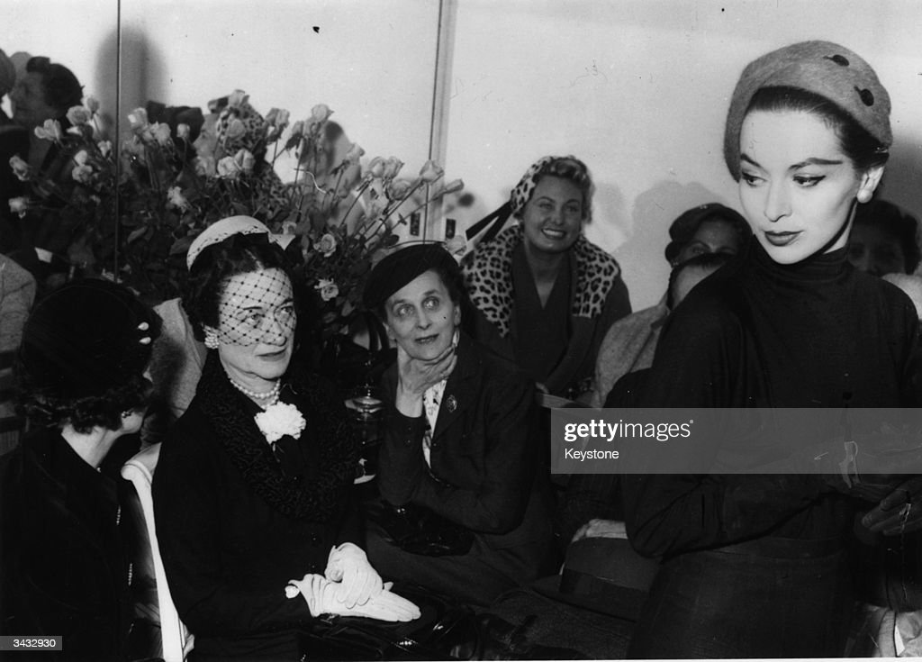 The Duchess of Windsor (1896 - 1986) attends a millinery show in Paris.