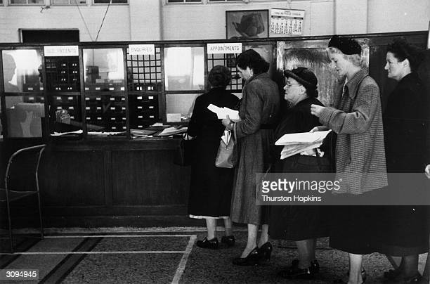 National Health patients queue at the outpatients' department in St Bartholomew's Hospital London Original Publication Picture Post 7333 You And Your...