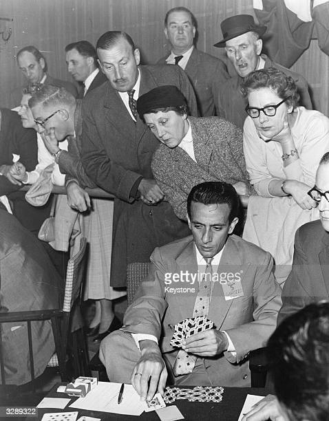 Onlookers watch a game in the British Bridge World Challenge Cup tournament at a store in London's West End The player is Garozzo of Italy
