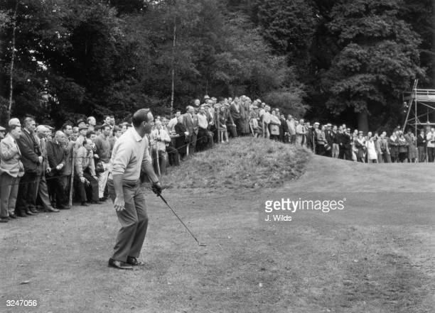 Arnold Palmer watches his approach shot to the green at the 18th hole during the Piccadilly World Match Play Golf Tournament at Wentworth