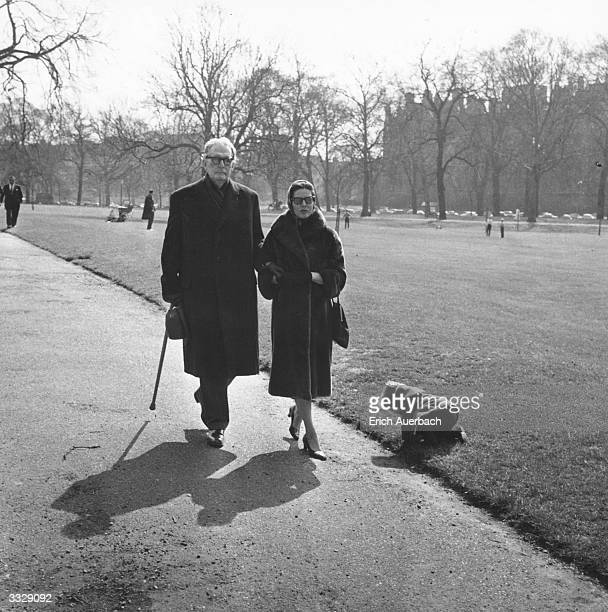 German conductor Otto Klemperer walking with his daughter Lotte Klemperer in Hyde Park, London.