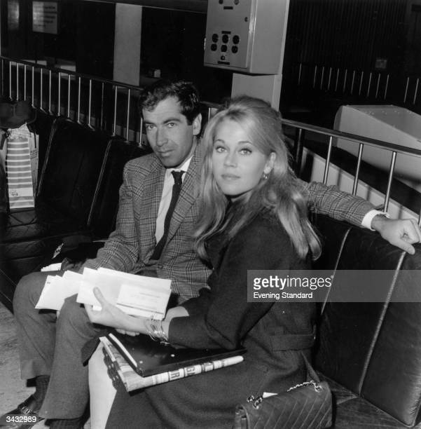 American actress Jane Fonda at London Airport with her husband French film director Roger Vadim
