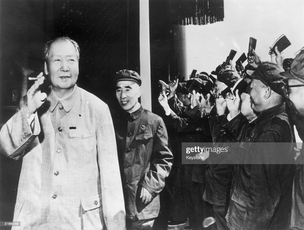 Chairman Mao Zedong (1893-1976) (left) together with Vice Chairman Lin Biao (1907-1971) acknowledges the waving of 'little red books' on the twenty-first anniversary of the People's Republic of China.