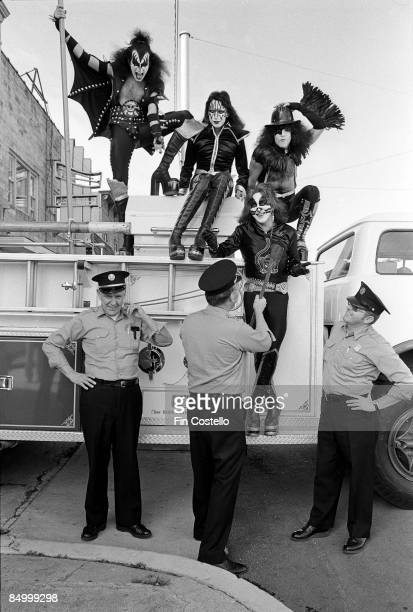 Photo of Gene SIMMONS and Ace FREHLEY and Peter CRISS and KISS and Paul STANLEY LR Gene Simmons Ace Frehley Paul Stanley Peter Criss posed on fire...