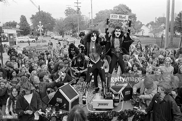 Photo of Paul STANLEY and Gene SIMMONS and KISS Paul Stanley and Gene Simmons posed on podium in front of crowd of people from town Day in the Life...