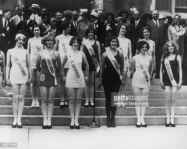 Miss America contestants representing their western home cities pose in onepiece bathing suits and sashes on the steps outside the Miss America...