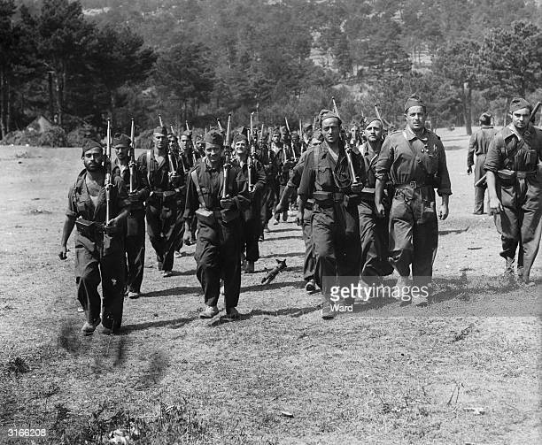 Republican soldiers moving up to the front lines in the Guadarrama Mountains during the Spanish Civil War