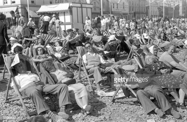 Tourists enjoying the sun on Douglas beach on the Isle of Man Original Publication Picture Post 196 The Isle Of Man pub 1939