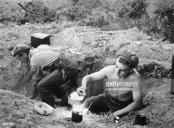 British servicemen cooking in a trench in Normandy Original Publication Picture Post 1797 The Road To Victory pub 1944