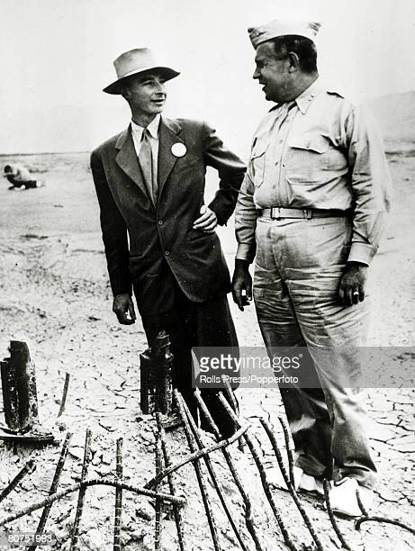 circa July 1945 Robert Oppenheimer left pictured with Brigadier General Leslie Groves at the site of the Atom Bomb test explosion at Alamogordo New...
