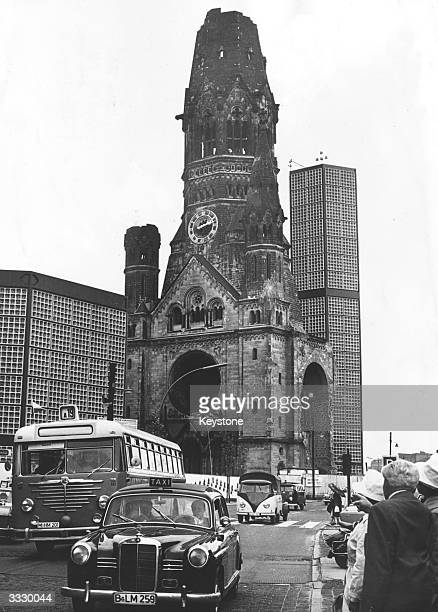 A Taxi and bus ply their trade along the Kurfurstendamm in West Berlin with the Gedachtniskirche in the background