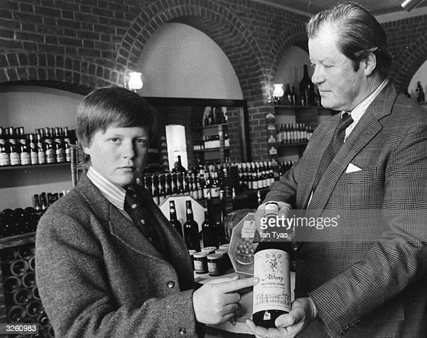 Charles Spencer Viscount Althorp aged 13 only son of the 8th Earl Spencer in their cellar at Althorp House Northamptonshire with some of their own...