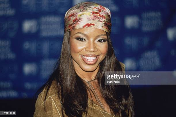 Pop star Shanice smiles at the camera wearing a multicolored bandana on her head at the MTV Video Music Awards at the Metropolitan Opera House at...