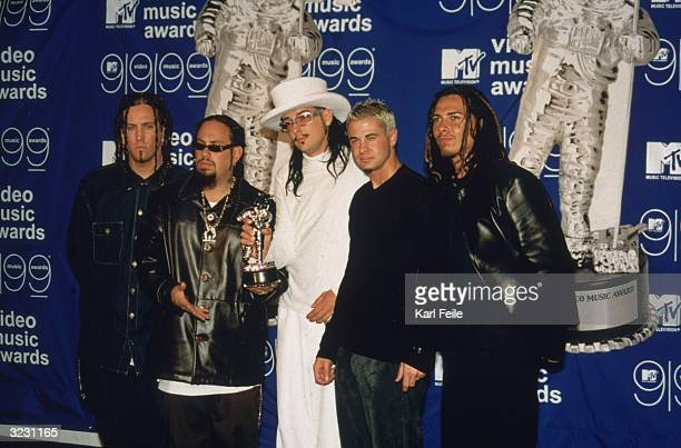 Rock group Korn featuring Jonathan Davis stands with their award at the MTV Video Music Awards at the Metropolitan Opera House at Lincoln Center New...