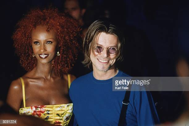 Somalian supermodel Iman stands with her husband British pop singer David Bowie at the MTV Video Music Awards at the Metropolitan Opera House at...