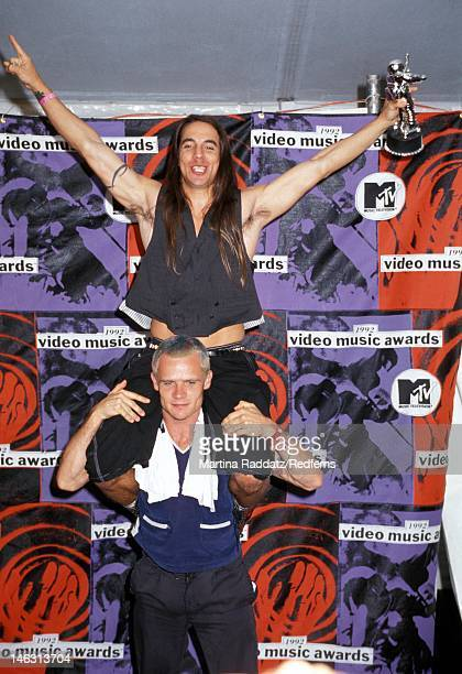 The Red Hot Chili Pepper's Anthony Kiedis sits on bassist Flea's shoulders while holding an award at the MTV Video Music Awards in the Pauley...