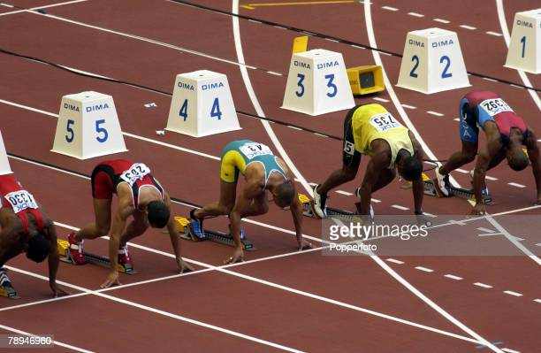 9th World Championships in Athletics, Paris, France, 24th August 2003, Mens 100m Heats, The competitors on their starting blocks