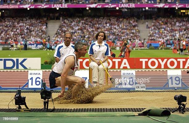 9th World Championships in Athletics Paris France 25th August 2003 Mens Triple Jump Jonathan Edwards of Great Britain lands in the sand pit well...