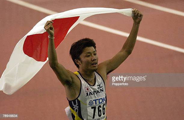 9th World Championships in Athletics Paris France 29th August 2003 Mens 200m Final Shingo Suetsugu of Japan celebrates with his flag after winning...