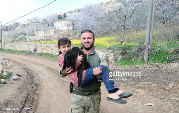 A 9yearold kid Meryem Bakir holding her goat poses for a photo with a soldier after returning to her house with her family members in Omer Ushagi...
