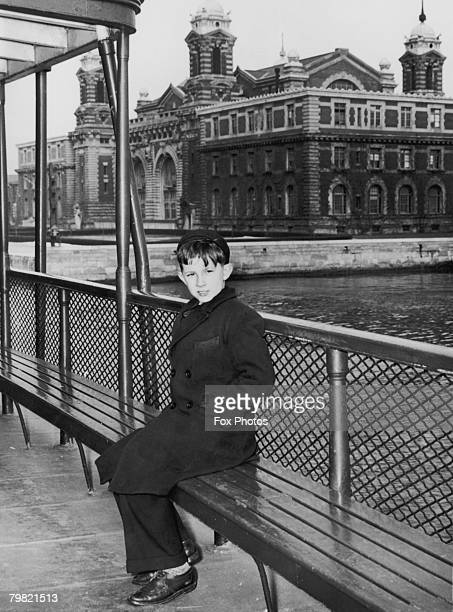 Year-old Michael Corrie, a refugee from England, takes the ferry to Ellis Island in New York during World War II, 1941. Evacuated from Bedford,...