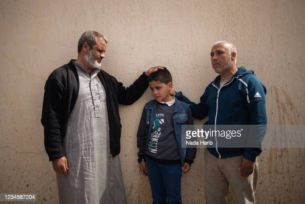Years-old Moad al-Falous, a survivor of Al-Kaneyat massacres, mourns over the death he witnessed of his brothers, Abdurahman , AbduAlmalek and...