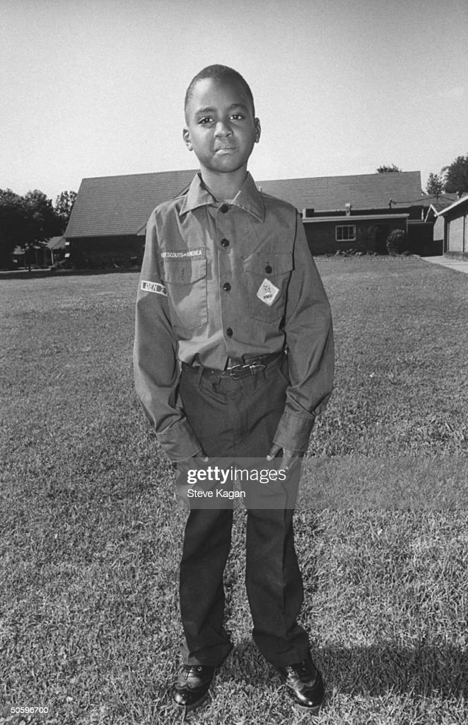 9-yr-old Corteza Hollins wearing Cub Scout uniform, standing