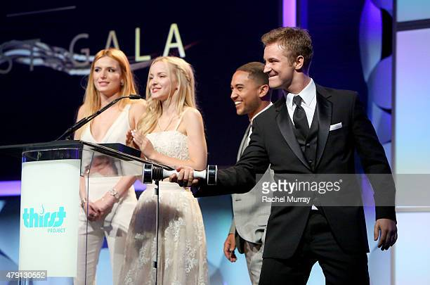 a Actors Bella Thorne Dove Cameron Tahj Mowry and Michael Welch speak onstage during the 6th Annual Thirst Gala at The Beverly Hilton Hotel on June...