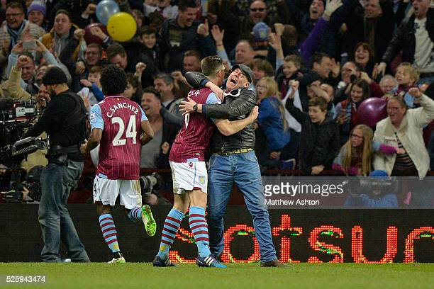 a Aston Villa fan hugs Ciaran Clark of Aston Villa after Scott Sinclair of Aston Villa scores a goal to make it 20