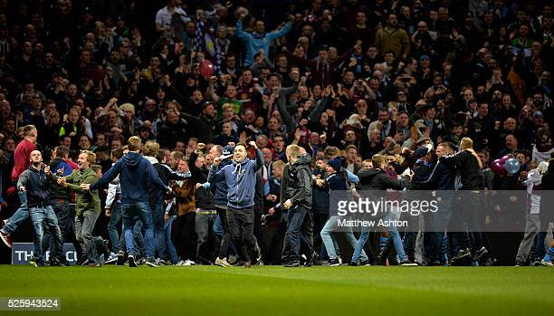 a Aston Villa fans invade the pitch during the match after Scott Sinclair of Aston Villa scores a goal to make it 20