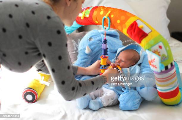 a Baby boy at home in his playpen.
