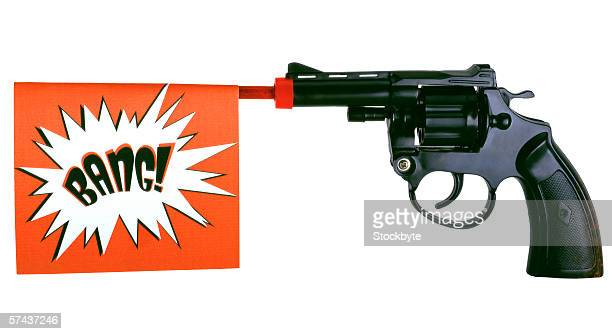 a 'bang' banner shot out of a toy pistol