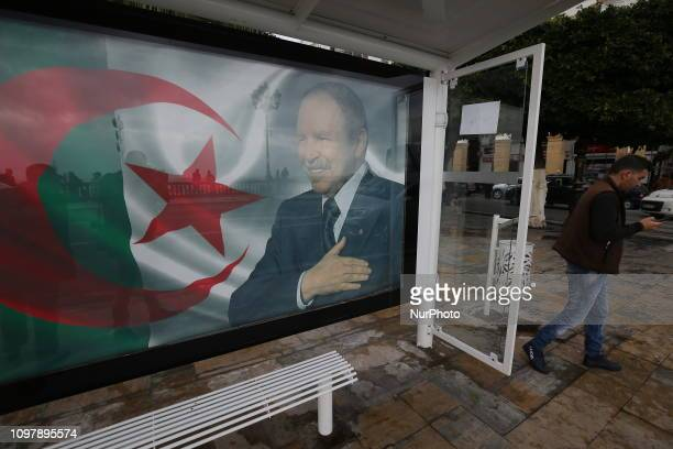 a banner carrying the Algerian flag with the portrait of President Abdelaziz Bouteflika in the Algerian capital on February 11 as the country...