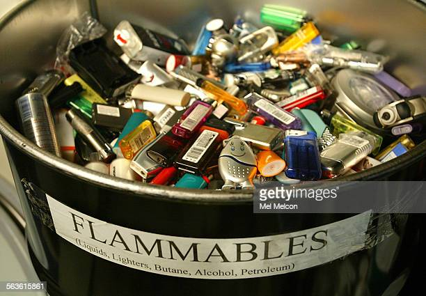a barrel containing cigerette lighters surrendered by passengers at LAX as they went through the xray machine before boarding the aircraft are turned...