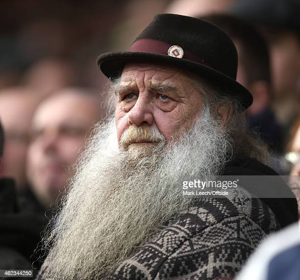 a bearded West Ham fan watches the match during the FA Cup Fourth Round match between Bristol City and West Ham United at Ashton Gate on January 25...