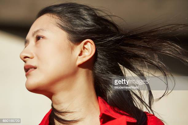a beautiful lady facing to the wind