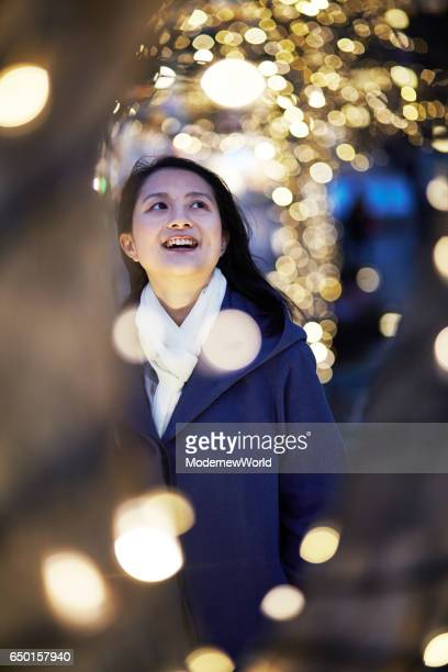 a beautiful lady smiling in the illumination