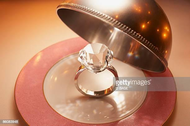 a big diamond ring in the silver dome.