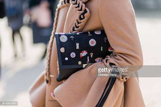 a black clutch outside Elie Saab during the Paris Fashion Week Womenswear Fall/Winter 2016/2017 on March 5 2016 in Paris France