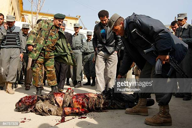 a body of a suicide bomber is taken out of the Ministry of Justice after Taliban militants attacked three government buildings in the Afghan capital...