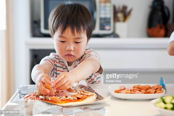 a boy cooking in the kitchen