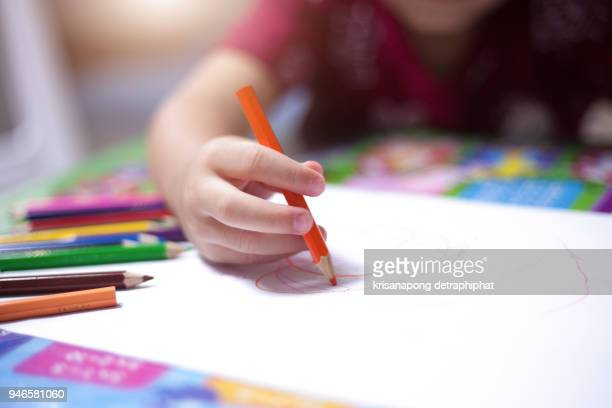 a boy drawing with colourful crayon ,kids Coloring