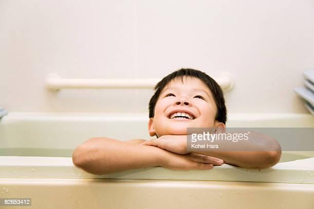 a boy in a bathtub