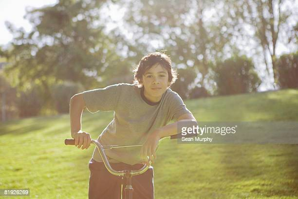 a boy on a bicycle